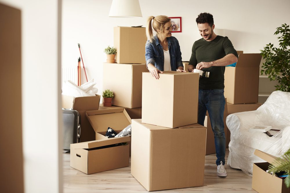 happy-couple-packing-boxes-for-move