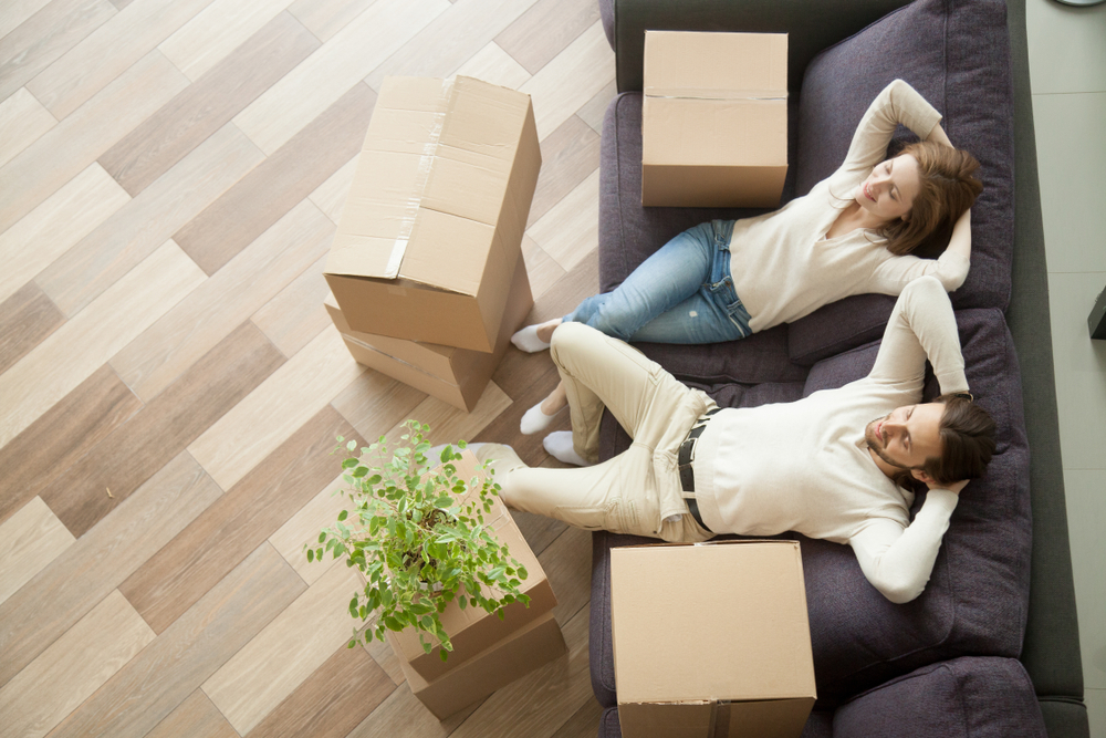 young-couple-taking-a-break-relaxing-when-in-new-home