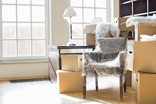 moving-boxes-and-wrapped-furniture-in-new-home