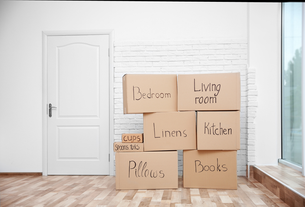 Cardboard boxes packed for moving. Boxes packed according to room, example, bedroom, living room, etc.