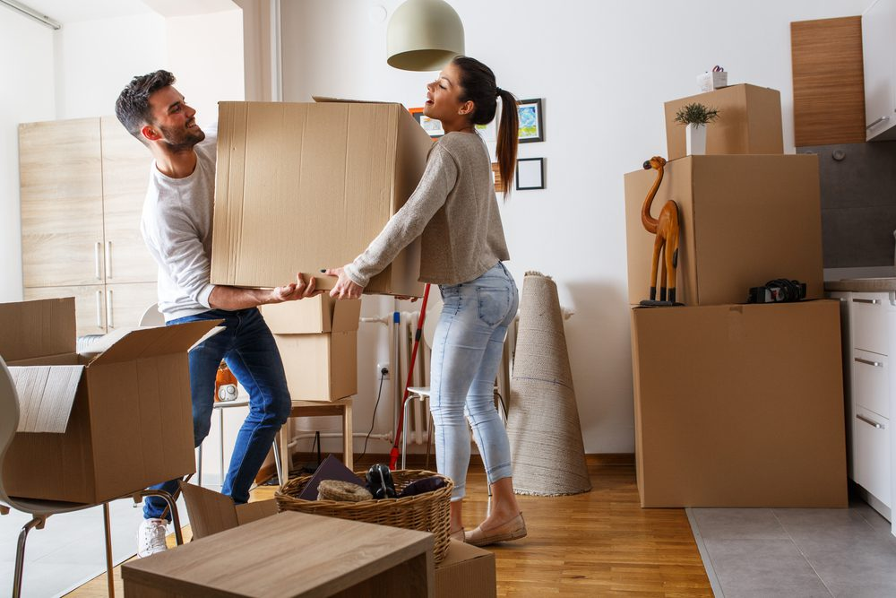 Couple is seen packing boxes for a move