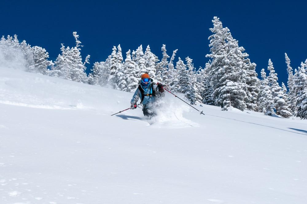 Woman skiing in deep powder near Wasatch mountain, Utah